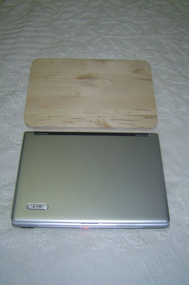 Laptop and cutting board size comparison
